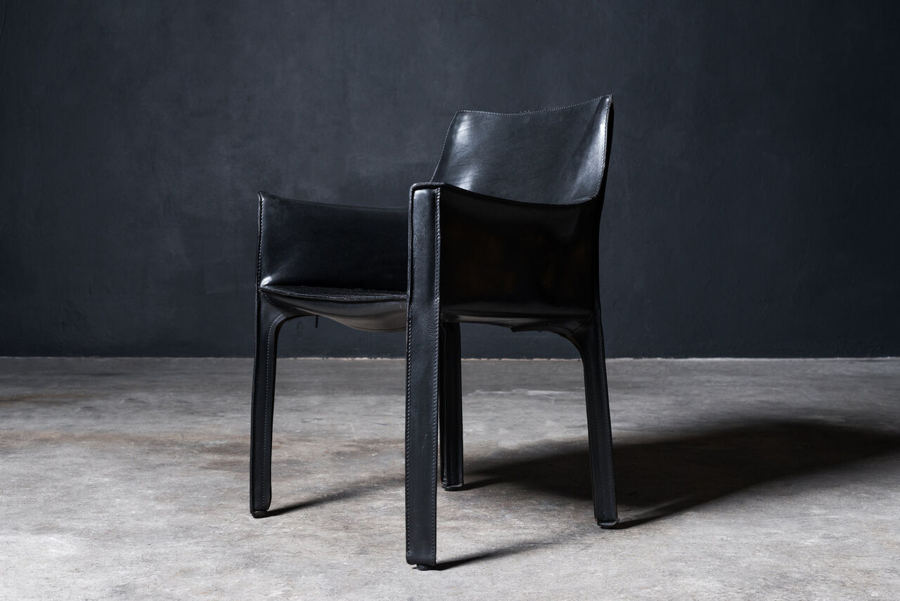 Black leather Cab Armchair by Mario Bellini