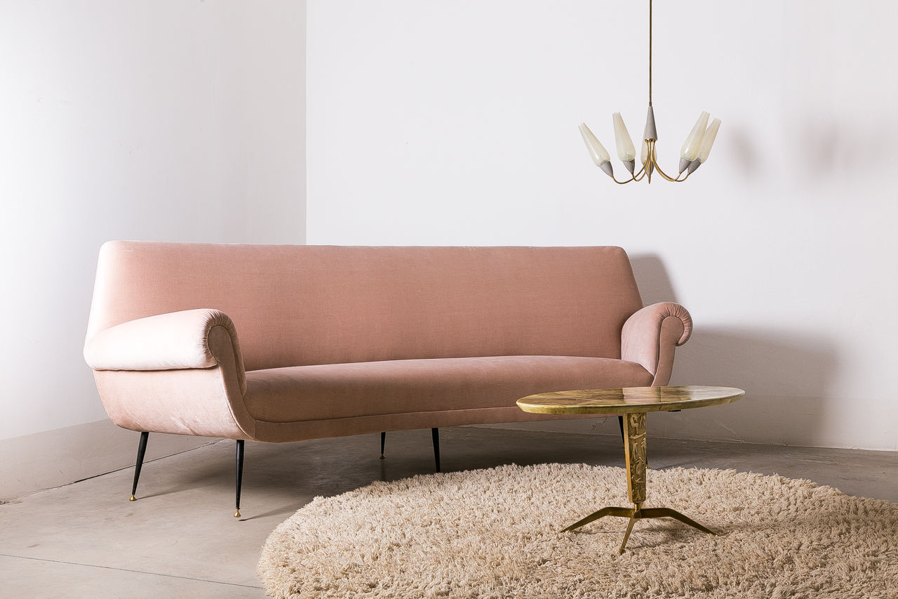 Curved sofa by Gigi Radici