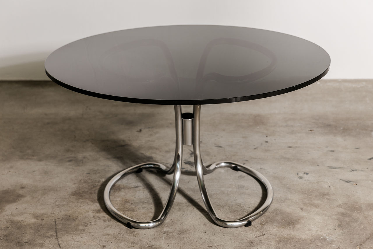 Glass dining table by Giotto Stoppino