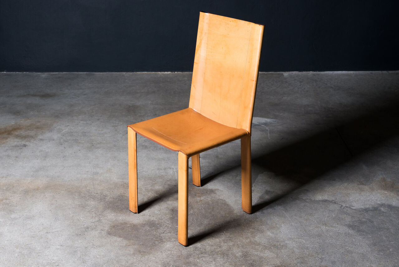 Leather dining chairs by Matteo Grassi