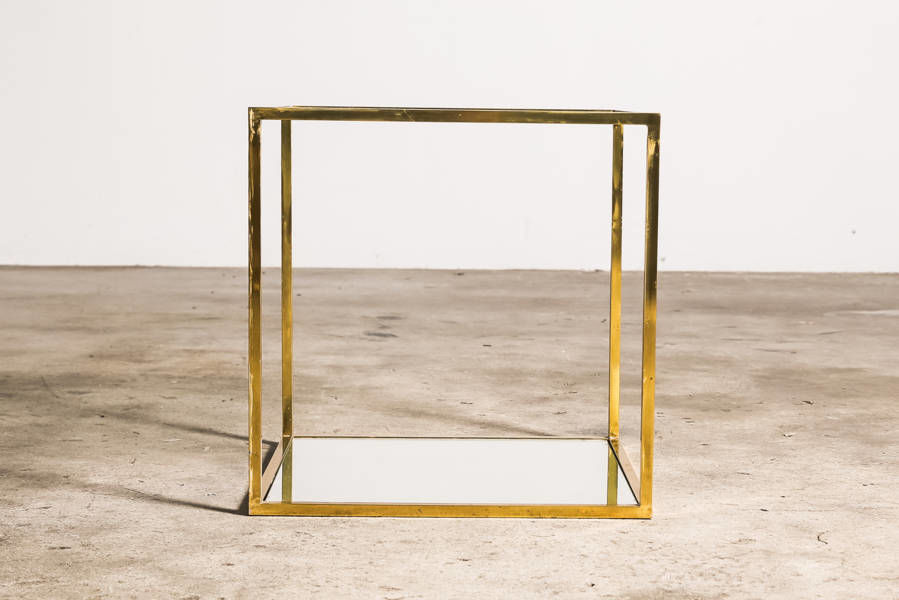 Mirrored brass and glass side table